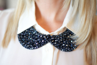 Bib necklace paired with collared shirt.