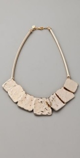 Statement necklace with flat, square stones.