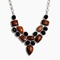 Statement necklace with black and brown stones on silver chain.