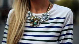 Long necklace worn with stripped crew neck long sleeve top.