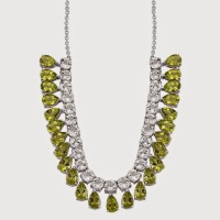 Pear shaped peridot necklace with round white topaz.