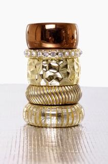 Gold layered bracelets.