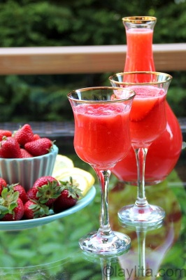 Strawberry lemonade in wine glass.