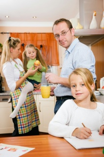 Family doing activities in kitchen.