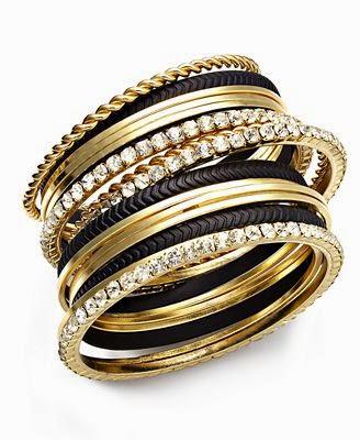 Bracelet stack with mixed metals.