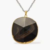 Black pendant in gold setting