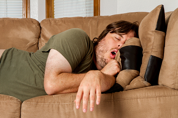 Man napping on couch.